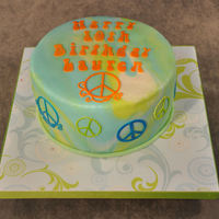 Tie Die Peace Sign Cake  Closest I could get to a tie die effect, but it still looks psychedelic and 60's to me! Lemon cake and lemon butter cream covered in...