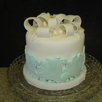 Ocean Wedding Cake This is a small centerpiece cake I made for a beach theme wedding.. I used a scroll mold for the fondant waves. The top is decorated with...
