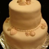 Seashells Yellow cake with Lemon cream cheese filling. Fondant with white chocolate seashells. Thanks for looking. :)