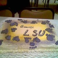 Geaux Tigers! Another sheetcake for the tigers! it has paw prints and drizzled icing on the side