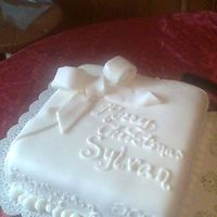A White Christmas  Christmas cake for my sister's job--sylvan learning center. It's a french vanilla almond cake covered in fondant with a ton of...