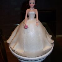 Bride Butter cake. I used fondant for her dress with pearl luster dust and silver/pink holagram glitter. Sugarpaste flowers for bouquet, she also...