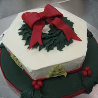 Christmas Cake Lemon chiffon cake with blueberry mousse filling. Covered in buttercream.