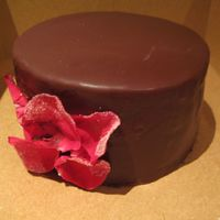 Chocolate Ganache Cake   Chocolate genoise with ganache filling and chocolate glaze. Edible petals coated in sugar.