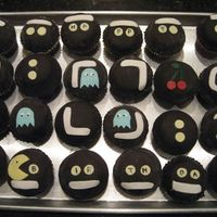 Pac Man Cupcakes  I saw this idea on someone's flickr page and had to try it. (sorry I can't remember who it was, but thank you whoever you are!)....