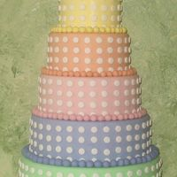 Pastel Tower Pastel toned cake with gumpaste bow topper