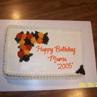 Pences_Birthday_Cake.jpg Sheet cake with fall colored mums. Definitely not one of my favorites, made the mums out of buttercream.