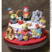 Circus Cake A Circus themed cake with gumpaste clowns and classical circus animal.