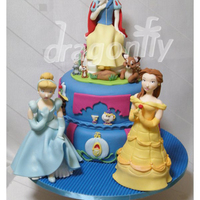 Princess Cake A cake featuring three gumpaste dolls of Disney Princesses, Cinderella, Snow White and Belle (Beauty and the Beast).
