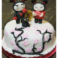Pucca Themed Cake A Pucca themed cake, with figurines of Pucca and of her beloved Garu. Both were made with gumpaste.