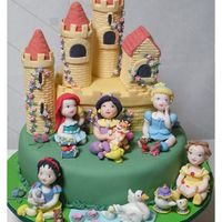 Royal Nursery Cake / Bolo Princesas Baby A cake with a partially edible cake (the central piece is also cake, but the towers' interior is styrofoam) and gumpaste figurines of...