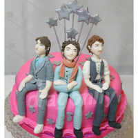 Jonas Brothers Cake A cake featuring gumpaste figurines of Jonas Brothers, made for a fan.