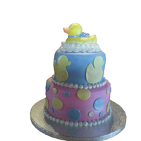 Rubber Ducky Sorry the pic looks kind of weird. I forgot to take pics with my backdrop before delivery so my friend had to crop the picture. This cake...