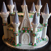 "Castle Cake This is my 3rd castle cake I've made and it's the largest! 6 layer 12"" round on the bottom and 6 layer 8"" round on the..."