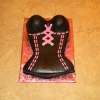 The Corset  Chocolate cake carved from a 9x13 frosted in buttercream and covered with MMF. All accents are MMF. Made to match the invitation to a...