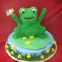 Frog Cake I made this frog cake from the Wilton 3D Bear pan. I got the idea from the Wilton site. Frog, pond, and flowers are buttercream. Lily pad...