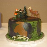 "Groom's Camo Cake This is the Groom's cake that goes with the wedding cake I just uploaded. All butter cream with plastic figures. 8"" chocolate."