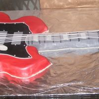 A Gibson Guitar This cake I did from a photo the groom gave me of his guitar. It's my first really detailed cake- and i enjoyed making it so much! It...