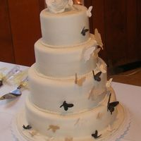 A Butterfly Cake This is a reproduction of a cake here on cakecentral. It's no way as good as the one on here, but it was my very first wedding cake! I...