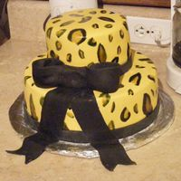 Cheetah Cake This cake I did for my sis-in-laws wedding shower. First time I ever painted cheetah print on fondant.