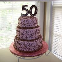 Rhonda50_Small.jpg   Butter cream frosting. I made the 50 out of chocolate candy melts and a candy mold.