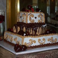 Gilmorewedding_Small.jpg  I do not know the original poster of this cake. My client saw it here and copied the pic. I searched for the cake and could not find it to...