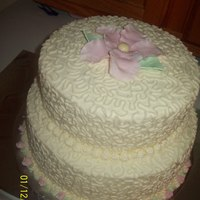 Birthday   2 tier Cake...for a birthday. Gumpaste accents. :D I love how it turned out but it took a really long time.