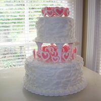 Heartcake_Small.jpg  Buttercream frosting. I made the hearts out of fondant and attached them with toothpicks. I piped a buttercream frosting border on the...