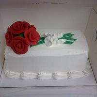 Roses The roses are made of royal icing, the frosting is pastry pride