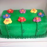 Garden Flowers ice cream cake. pastry pride frosting airbrushed with bc decoration