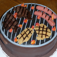 Father In Laws Birthday Bbq Chocolate cake, all covered in fondant and everything on the grill is made from fondant