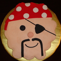 Pirate Cupcake Cake Vanilla cupcakes covered in buttercream with fondant accent. This was my first cupcake cake. TFL!