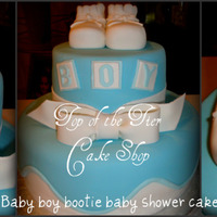 Baby Boy Bootie Baby Shower Cake 2 tiered cake. I believe it was a 6 inch and a 10 inch cake. Vanilla w/ dulce de leche filling covered in fondant. Booties and bow are made...
