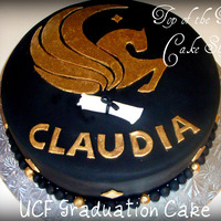 Ucf Graduation Cake 12 inch vanilla cake with dulce de leche filling covered in black fondant. I made a template for the pegasus and cut it out with fondant....