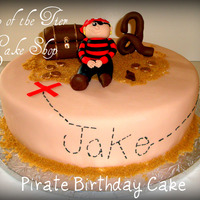Pirate Birthday Cake 12 inch vanilla cake w/ dulce de leche filling covered in fondant. Pirate, treasure chest, coins and number 2 are all made of fondant/...