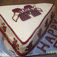 Mississippi State Made this for a 50th birthday party... It's a white and choc cake with BC icing and MMF accents...Thanks for lookin