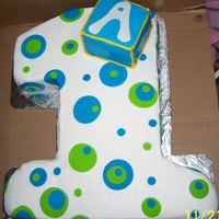 Number 1 With Polka Dots  Made for a baby First birthday BC icing with the polka dots in MMF... Made the box so that the Birthday boy could have that as his own cake...