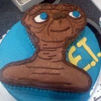 E.t.  This was by FAR the HARDEST cake that I have ever done in my life.. Trying to make him look like E.T. and not some Star Wars person.. I...