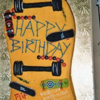 Skateboard Cake This skateboard cake was a white cake iced in buttercream. The wheels are made with fondant and oreo cookies. The mini finger skateboards...
