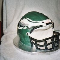 Eagle's Helmet  This was the very 1st cake I ever sculpted. It was pound cake covered in fondant which I was not good at yet but it turned out ok. It was...