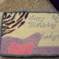 "Hannah Montana Inspired Cake I got parts of the design from other cakes on cake central. The cake is white. Frosting is buttercreme. The ""zebra stripes"" are..."