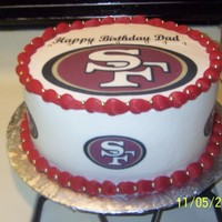 49Ers Cake white cake with banana cream filling, buttercream and edible image.