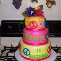 Hippie Cake buttercream and fondant with artificial flowers.