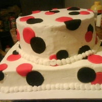 Polka Dot This was a cake done for a customer who's colors were black and red.. They loved it.. Thanks for looking.