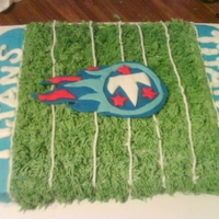Titans Titans Football cake.... Football field is done in bc icing and the symbol is fondant. Hope you like