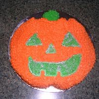 "Pumpkin This was just an experiment. I carved the cake out of a 8"" round and use the center of a cupcake for the stem. I used luster dust to..."