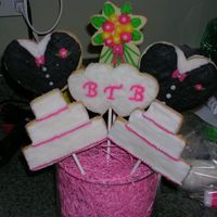 Wedding Cookie Bouquet I used hearts to make the Tux's and freehanded the cake with a pearing knife, I also used the shooting star from the wilton set to...