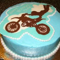 Motocross Cake White cake covered in butter cream. The motor cycle is a chocolate transfer. This was by far the most detailed chocolate transfer I have...