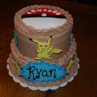 Pokemon  buttercream with fondant accents. Took me three hours to make buttercream for this cake on a very humid day. Wasn't setting up right...