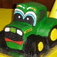 John Deere Tractor   This was for my nephew's first birthday. Completely hand carved, covered in buttercream. First time ever attempting this.